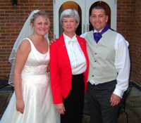 Leslie Watson - Professional Toastmaster with Bride and Groom